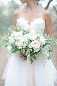 Elegant white peony wedding bouquet…