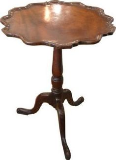 The formal Pie Crust Tripod Table appeared about 1750 in England. Mahogany had become popular & nearly all were of that wood.The tops usually tipped & were made round w/ edges scalloped & raised in a molding effect.The feet were often ball-and-claw & the pedestals & knees were sometimes beautifully carved.Extremely popular in 18th & 19th century Britain & America.Used for tea, needlework or games. Typically incorporated a titling mechanism which allowed the table to be easily moved & stored British Country, English Manor, Wood Tables, Table Scapes, Primitive Decor, Small Tables, Early American, 17th Century, Gd