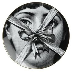 tie a ribbon on my nose, I can untangle any of your bows.....