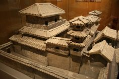 A Han Dynasty pottery tomb model of a palatial residence.