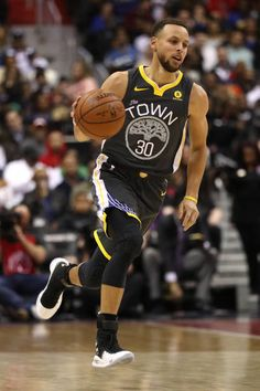 Stephen Curry of the Golden State Warriors dribbles the ball against the Washington Wizards during the first half at Capital One Arena on February 28...