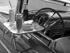 """window tray at the drive-in..burgers in a plastic reusable basket, reusable ketchup and mustard squirters, glass bottled soda also reusable....hmmm...pretty smart in the """"old days"""""""