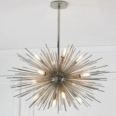 Zanadoo chandelier by arteriors polished nickel large 12 light midcentury modern moonbeam chandelier with starburst rays on polished nickel or golden antique brass this 12 light contemporary chandelier adds aloadofball Choice Image
