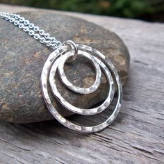 Hey, I found this really awesome Etsy listing at https://www.etsy.com/listing/63831770/silver-circle-necklace-hammered-rings