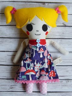 Meet little sweet and huggable Cora.This pretty rag doll was handmade out of cotton, linen and felt fabrics. Her dress was embellished with ricrac, ribbons and buttons. She has two bow buttons ...