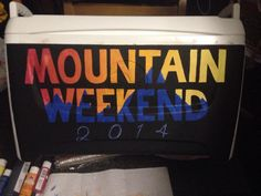 Painted cooler idea for a mountain weekend, sunset background