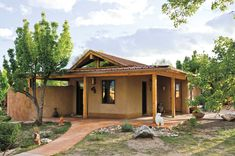 """Our story on """"Building Earthen Homes"""" will make you want to start making adobe bricks and filling earth bags. Moving earth around to build a house isn't easy, but can result in beautiful and environmentally awesome dwellings. From MOTHER EARTH NEWS magazine."""