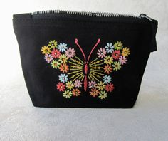 Hand Embroidered butterfly makeup bag / change purse. #giftsforher #handmade #handembroidery #multicolor #floral #blackpouch #changepurse #makeupbag