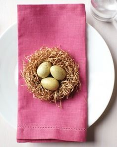A baby nest awaiting each guest at an Easter table adds a sweet addition. For more Easter fun, check out http://paaseastereggs.com.