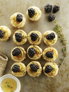 """savory goat cheese tartlets w/ honey & blackberries. I wish there was a link to this recipe. We'll have to imagine, and invent."""