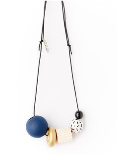 A little bit of everything....An eclectic mix of hand painted wooden beads of varying sizes and shapes strung on an adjustable black leather cording for versatility.
