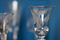 A wineglass decorated with a white rose and two buds. The white rose refers to the James VIII, exiled Stuart monarch and the two buds are his sons Charles and Henry. The glass would have been used to toast the health of the 'King across the water'. Glass Museum, National Archives, Hurricane Glass, White Roses, Wine Glass, Scotland, Sons, Symbols, Google Search