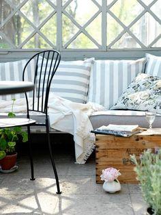 Cozy patio.  Stripes + lattice work