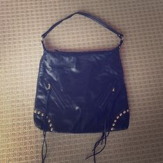 Sherry Wolf Soft Black Leather Bag Sherry Wolf Soft Black Leather Shoulder Bag. Very soft leather, amazing quality, three exterior pockets,  one interior. Worn a couple of times, in excellent condition. Dim: 16 (w) x 14 (h) with 8 in handle drop. Sherry Wolf Bags