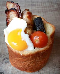 The award-winning 'full English bunny' is a hollowed-out brioche loaf filled with bacon, button mushrooms, sausage, bobotie spiced beans, black pudding and a fried egg. Best Breakfast, Breakfast Recipes, English Breakfast Ideas, Breakfast Buffet, Bacon Dishes, Food Porn, Cafe Food, Great Recipes, Recipe Ideas