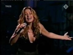 "Lara Fabian - sings the Italian song ""Caruso"" ( with onscreen Lyrics ).  The first time I watched this, tears of enjoyment trickled down my face.  I hope you enjoy it as much as I do.  It FEEDS my Soul's need for PASSION INTENSITY.  An excellent meal for the heart.  Brava Lara. Ti vole been."