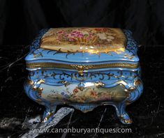 Stunning Sevres style porcelain jewellery box. - There is even a floral spray on the inside when you open the box up. - Adorned with a stunning array of painted floral designs. - Factory stamp on underside of box.   eBay!