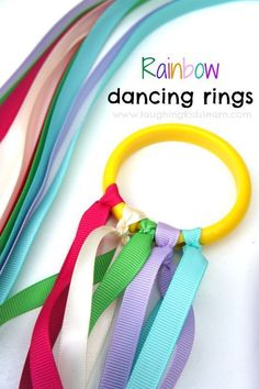 How to make beautiful dancing ribbon rings for kids. Great homemade toy kids will love to play with - Laughing Kids Learn #dancingribbons #diytoys #ribbonsforplay #colors #outdoorplay #dancingrings #ribbonrings #rainbowrings #lovetoplay #preschool #preschoolers #earlyyearseducation