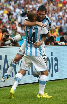 Lionel Messi of Argentina celebrates scoring his team's second goal and his second of the game with Javier Mascherano during the 2014 FIFA W. Lionel Messi, Messi Vs Ronaldo, Messi And Neymar, Messi 10, Messi Photos, Argentina National Team, Football Fever, National Football Teams, Soccer World