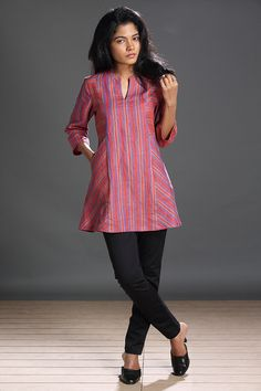 Paroe Striped Tunic This linen tunic in an unusual combination of dusky rose with saffron & turquoise is a clever play of stripes with chic slant pockets. Paroe is the Portu. Short Kurti Designs, Kurta Designs Women, Tunic Designs, Dress Neck Designs, Kurta Neck Design, Kurti Patterns, Mode Hijab, Short Tops, Indian Designer Wear