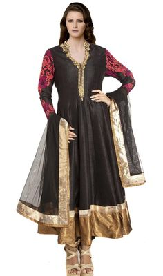Spell charm and elegance dressed in this black dupioni raw silk Anarkali churidar suit. Beautified with lace, patch, resham and stones work. #AwesomeDesignerCollection
