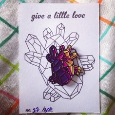 Give a little love with this 1 in height geometric heart pin.
