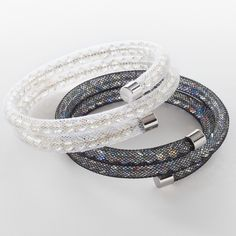 """Crystal Paradise Shine crystal.sparkles from within a white mesh bracelet rhodium plating; 2 ¼ """" inside diameter; expands to fit wrist."""