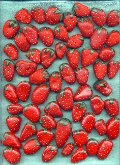 Rocks painted to look like strawberries! Cute party idea for kids or painting project for your garden. Strawberry Rocks are so cute!
