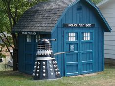TARDIS Shed and Dalek... Going to build a goat house that looks like this! (The Dalek will be a food/water trough)