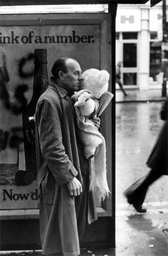 Man with Teddy Bear at bus stop, Wales, 1973 - could bear really be a hidden camera?