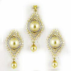 The South Sea Pearl Gold and Diamond Pendant Set #gold #pendant #diamond #earrings #beauty #fashion