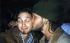 Shannon Hoon, lead singer of Blind Mellon planting a kiss on the cheek of Layne Staley, front man for Alice in Chains.