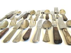 New to LaurasLastDitch on Etsy: Rustic Mismatched Flatware Set Stainless Silverplate Nickel Silver Wood Handles Cabin Decor (38.99 USD)