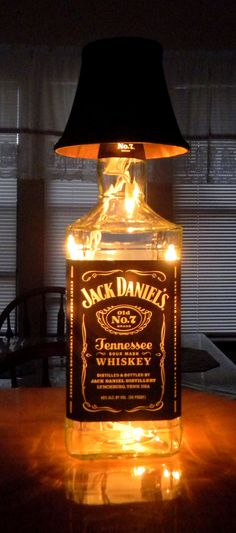 14 original decorations to make from Jack Daniels bottles . - 14 original decorations to make from Jack Daniels bottles – DIY – Tips and DIY - Lampe Jack Daniels, Jack Daniels Bottle, Jack Daniels Decor, Liquor Bottles, Bottles And Jars, Wine Bottle Crafts, Bottle Art, Big Bottle, Glass Bottle
