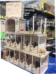 """Toy Horse Barn with 6 Stalls. The Barns are stackable and keep your Breyer horses nice and cozy. The barn is 32"""" x 11.5"""" x 11"""". Fits classic and most Traditional Breyer Horses. Customize your barn with a farm name and/or Stall Names."""