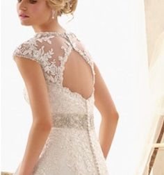 2b1a05fa4e65d Detachable keyhole back accessory. Beaded lace appliqué on tulle, detailing  more close to the