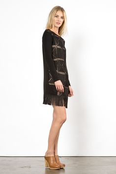 The 20s and 60s meet together in this awesome crocheted tassel dress. With its crochet squares throughout the body, taupe colored lining and soft tasseling at the hem, its perfect for shimmying at you