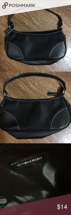 Victoria's Secret - Small NWOT Satchel Purse Victoria's Secret brand black with silver hooks, small satchel purse, NWOT. Perfect size for a night out! Please be sure to check out all of my other boutique items to bundle and save. Same day or next business day shipping is guaranteed. Reasonable offers will be considered! Victoria's Secret Bags Satchels