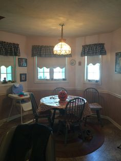 Before photo of dining area next to kitchen.