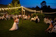 Brighten up your backyard wedding by adding strands of lights - find lights on oogalights.com