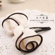 love this rolled bow idea. Could make for a nice fascinator if done in vintage lace or fascinator mesh.