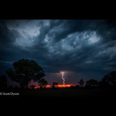 Photo Scott Dyson. The #drought we are experiencing  received slight relief from this magical #electric #storm a few nights ago! It was an exciting shoot being amongst the #lightening topped off with a crazy #cloud sunset #safari @natgeowild @safariliveofficial