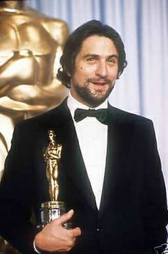 Robert De Niro with Oscar for Raging Bull