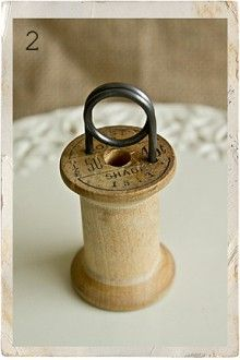 Great for market tables: wooden spool price holder