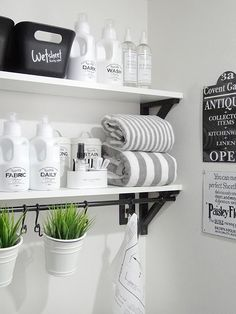 The Laundress products fit right in with this black, white and grey laundry room.