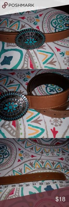 Western Style Belt - Turquoise and Silver Beautiful tan/camel color belt 70% leather, 30 % non leather.  Large belt buckle turquoise and silver with flower in the center.  36 inches long EUC.  Only worn a couple of times.  Great for any western look. Unknown Accessories Belts