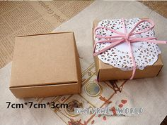 Youll receive 50 pcs kraft paper box, it not include any ribbon stickers and other decorative items. Material: kraft paper size:7.0*7.0*3cm we have other size: 5.5*5.5*2.5cm, 6.5*6.5*3.0cm 7.0*7.0*3.0cm 7.5*7.5*3.0cm 8.0*6.0*3.0cm 8.5*7.5*3.5cm 8.5*8.5*3.5cm 9.0*6.0*3.0cm