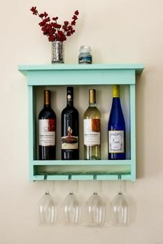 DIY wooden shelf for bottles of wine and glasses in mint green