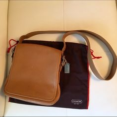 Leather Coach Messenger bag Camel colored Coach leather messenger bag. Has some minor scuffs on front, back, strap and bottom as well as some pen stains on the interior. Price reflects this. Coach Bags Crossbody Bags