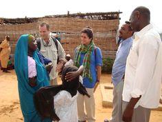 Bridge Foundation volunteer, Lisa Ruiz (middle) of Blue Mountain Capital and Stephen Skakel, Bridge Foundation at Kalma Camp, South Darfur, speaking with camp residents and IMC staff 2009